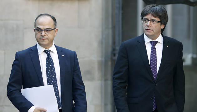 El conseller de Presidència, Jordi Turull, i el president de la Generalitat, Carles Puigdemont, ahir.