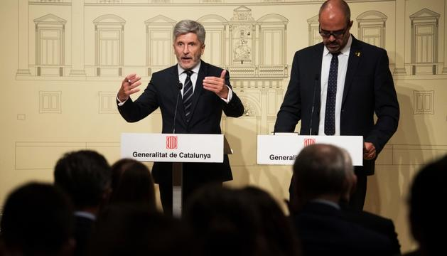 Fernando Grande-Marlaska i Miquel Buch, ahir.