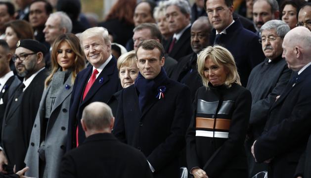 Macron junt amb Angela Merkel i Trump, ahir.