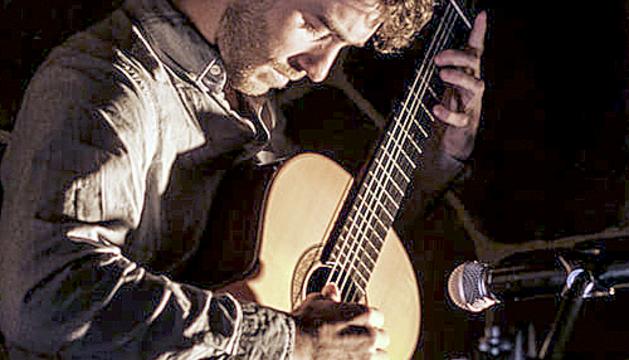 Llum i guitarra al Llac d'Engolasters