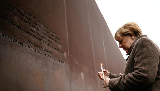 Merkel recordava les víctimes, ahir.